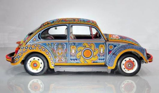 A Car Beautifully Covered With Beads